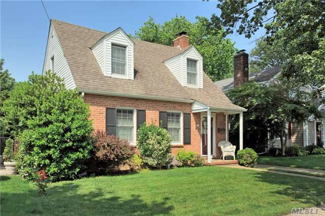 Immaculate Cape On Beautiful Quiet Street In The Village Of Mineola, Lr W/Fp, Fdr, Kitchen, Fam Rm, 2 Br, 1 Bth, Finished Basement, Laundry Rm, 2 Zone Gas Heat, New Anderson Windows Throughout, Hardwood Flrs, Private Fenced Yard, Walk To Park, Summer Concerts In The Park, Playground, Tennis, Library, Schools, Shops, Winthrop Hospital & Train. Pool Membership Available.