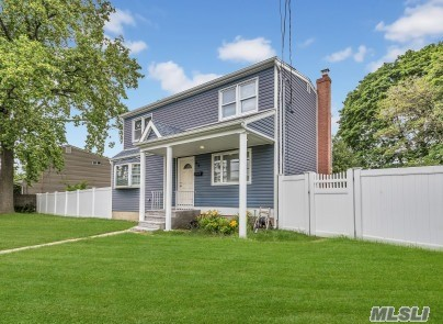 Diamond Expanded Cape!***All New! Siding, Windows, Kitchen, And Baths! Detached Garage! Full Basement With Ose! Fenced Yard.