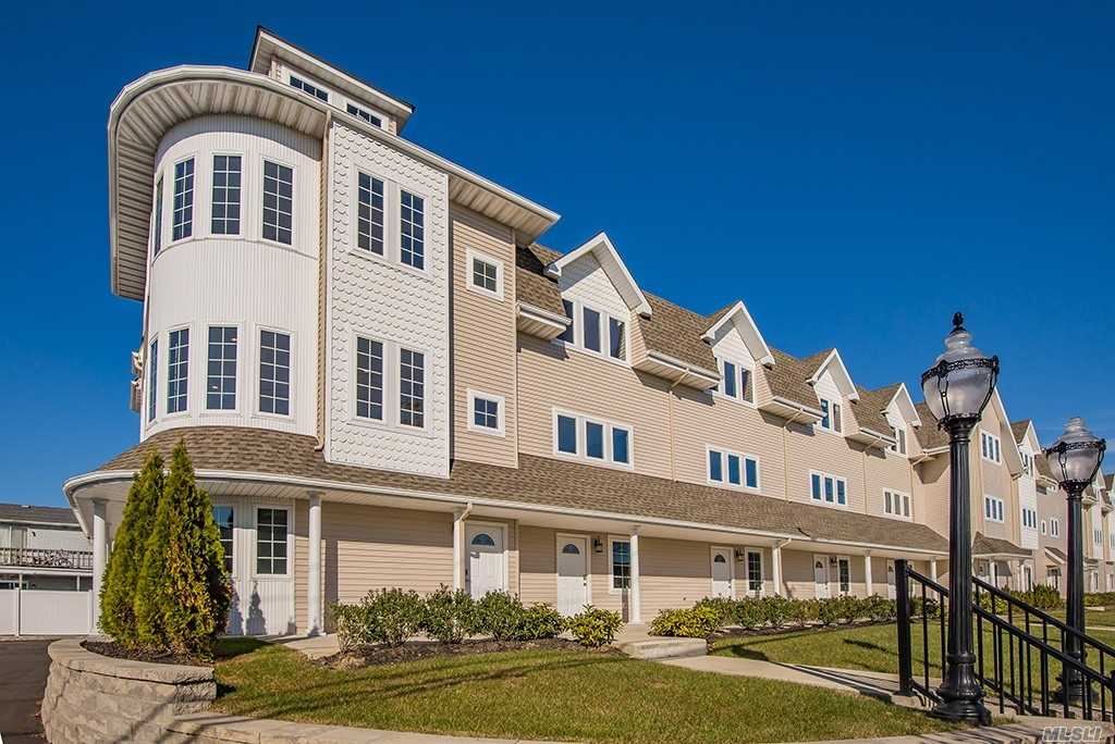 Brand New Gorgeous Townhouse (Unit #8) Features Fema-Compliant High Flr Elevation, 2 Bdrms, 2.5 Baths, 2-Car Gar, Entry Lvl Office/Den, Huge Wide-Open Main Lvl Living/Dining Rm Combo Next To Custom E-I-K W/Granite Ctops + Ss Appliances, Oak Flrs Throughout, & Prof Landscaping. Opportune Loc: Within Quiet Development Yet Close To The Mile, Marinas, Dining, Shops, Rr, +++!