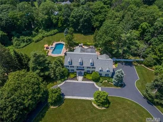 This Distinctive 6 Bedroom Home Has Been Completely Rebuilt With Great Care To Reflect The Charm And Elegance Of A Country Manor. The Hub Of The Home Is The Chef's Kitchen And Adjacent Great Room With A High Beamed Ceiling, Stone Fireplace And Wet Bar. The 2 Acre Property Is A Shangrila With Gardens, In-Ground Pool And Is Surrounded By A Brick/Bluestone Patio.