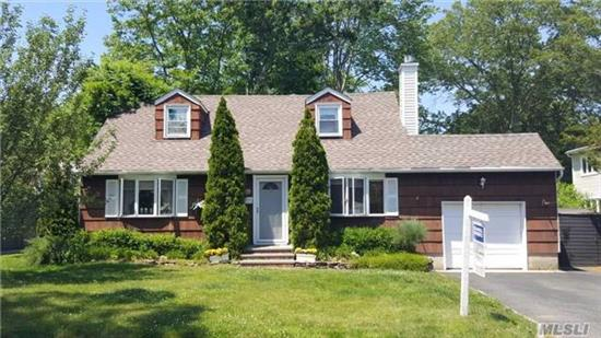 Triangle Area. Mint Cape W/ Hardwood Floors Throughout, Fireplace In Living Room, Den, Basement W/ Ose And Access To Parking In Front And Rear Of Property