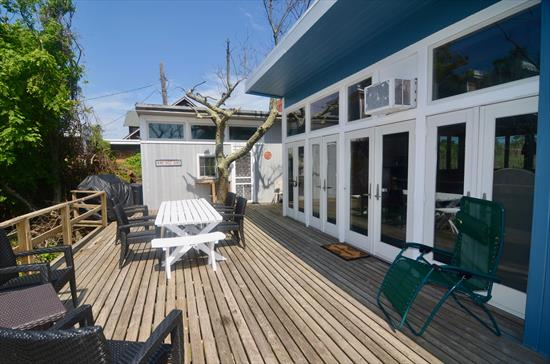This charming 4 bedroom, 2.5 bathroom home boats spacious decks, semi open concept living space and comfortable bedrooms. 3 bedrooms in the main house and 1 bedroom in the guest house! This is the perfect summer getaway!