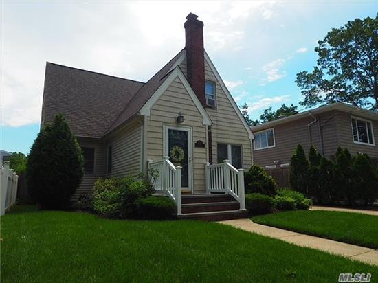 Terrace Tudor Cape Updated With Granite Kitchen, Huge Dining Room And Spacious Master Bedroom. Hardwood Floors Throughout, Detached Garage And Fully Fenced Yard. Perfect Location In North Oceanside - No Flood Insurance Required! Super Low Taxes!