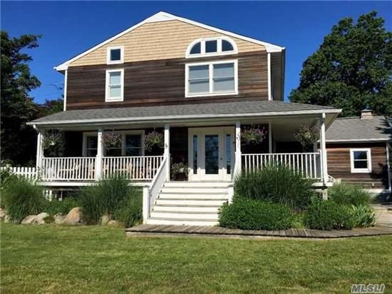 Crab Meadow! Turn-Key Colonial With Open Floor Plan And Wrap-Around Porch. Views Of Golf Course & Estuary. Updates Include: Kitchen, Cac, Splash Pool, Paver Patio, Hardwood Floors. Sophistocated Beach Area Home!