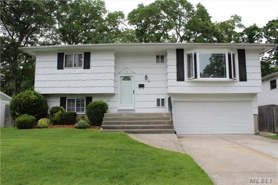 Large Hi-Ranch With 4 Bdrms, 1.5 Baths, & Updated Eik. Wood Floors On Main Level.