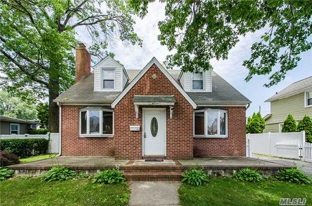 A Beautiful Brick Cape With Spacious Patio And Fenced In Backyard. Living Room Fireplace, Newly Renovated Kitchen With Stainless Steel Appliances, Hardwood Floors