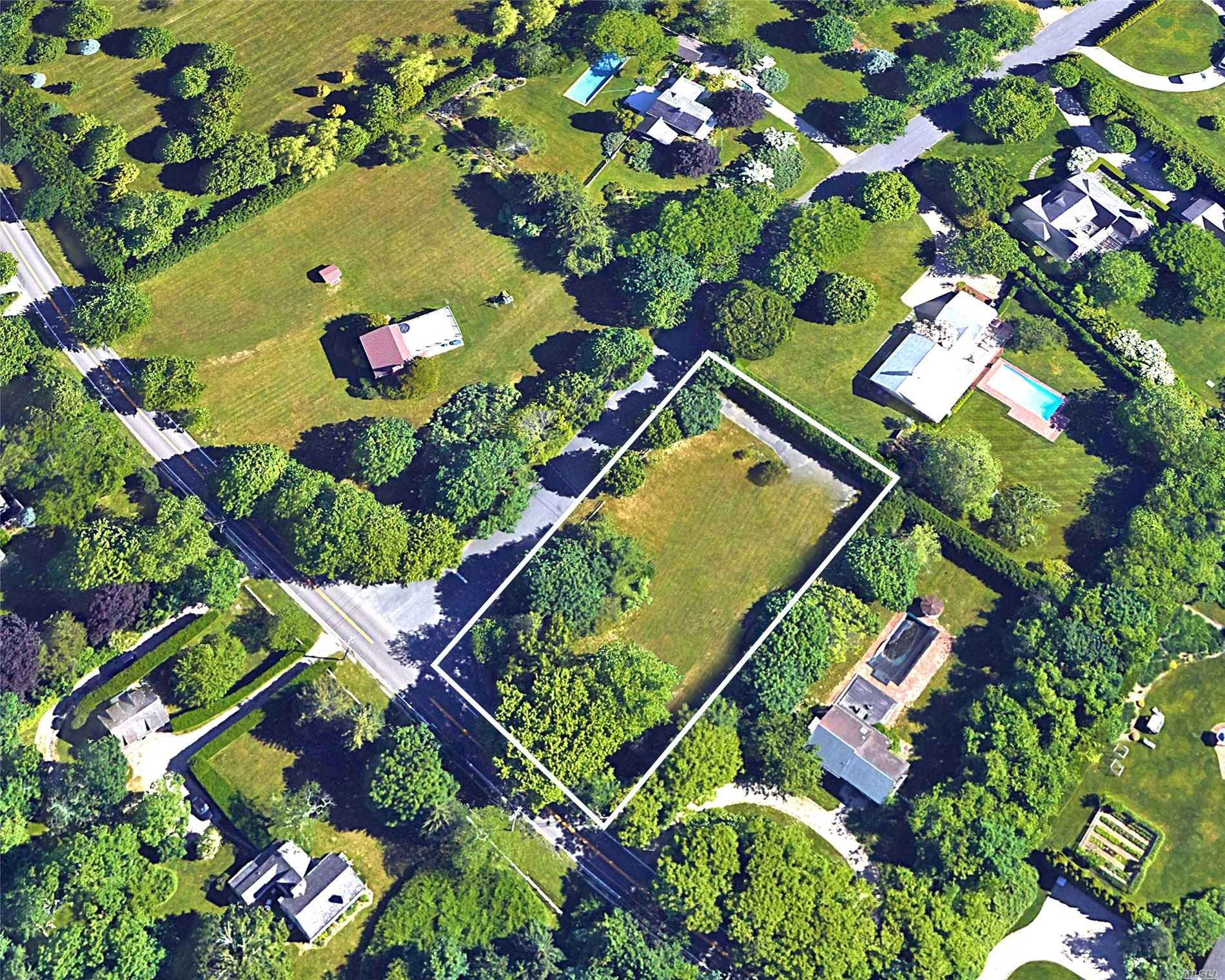 Water Mill Residential Land - Prime South Of The Highway Location Close To Bridgehampton. This 0.59 Acre Corner Lot Offers An Outstanding Opportunity To Create Your Own Hamptons Retreat. Existing House On Property Likely A Tear-Down. Grandfathered Under R-40 Zoning Dimensions For A Greater Building Envelope. Reduced For Quick Sale By Motivated Seller.