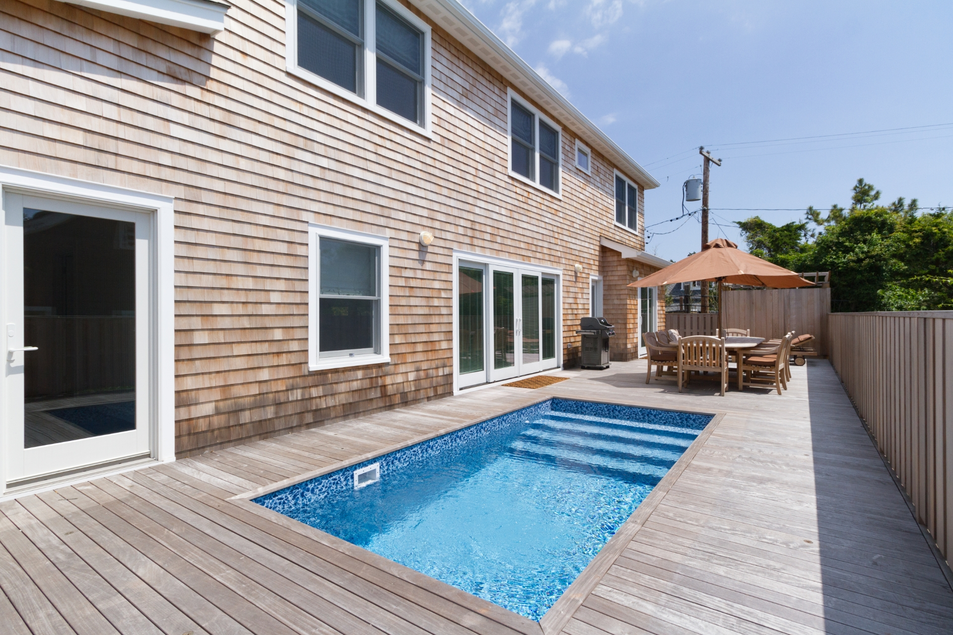 New construction close to the beach with a Pool! Only a 2 minute walk to the beach! This 4 bedroom 2.5 bath house has everything you need to enjoy life on Fire Island.  The first floor of the home consists of a screened porch which opens into a large great room with fire place.  Open seating throughout the living room, kitchen, and dining area provide enough room for the whole family to comfortably spend their time together. The living room features oversize french sliding doors that open onto the pool deck. The first floor is completed by a private master suite that includes its own deck access. On the second story, the home features 3 ample size bedrooms and a full bathroom. The 2nd story also features a convenient laundry room. All the bedrooms have lots of windows making them light and bright. This house is move-in ready. Call to schedule your showing!