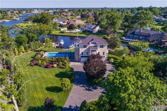 Custom Built Colonial Features Open Style Living Open To The Large Deck. Master W/ Large Full Bath, 2 Walk In Closets And Private Balcony,  2 Beds Joined By A Jack/Jill Bath, Second Floor Laundry, Elevator From Garage, 2.5 Car Attached Garage, Ig Salt Water Pool, 271' Cement Seawall And Boat Lift All On .71 Acre... Do Not Miss This Home...