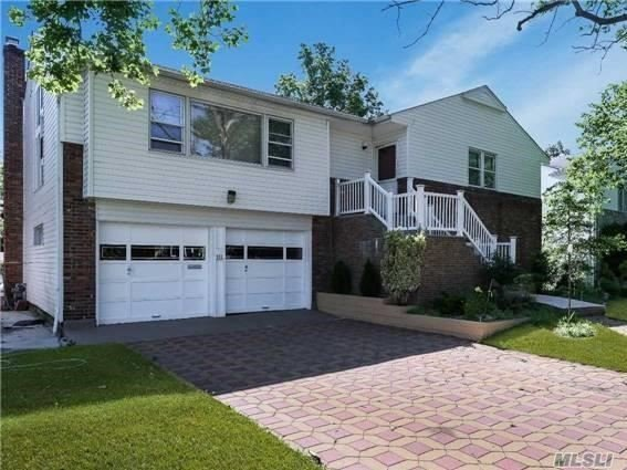 Spacious 4 Bedroom, 3 Bath Hi-Ranch With Cathedral Ceiling In Living Room,  Dining Room. Beautiful Hardwood Floors, Renovated Kitchen, Stand Up Attic, Lg Family Room/Den W/Fpl, Sliders Out To Backyard, Office, Walk In Closets & Additional Bonus Room, New Roof, New Boiler.