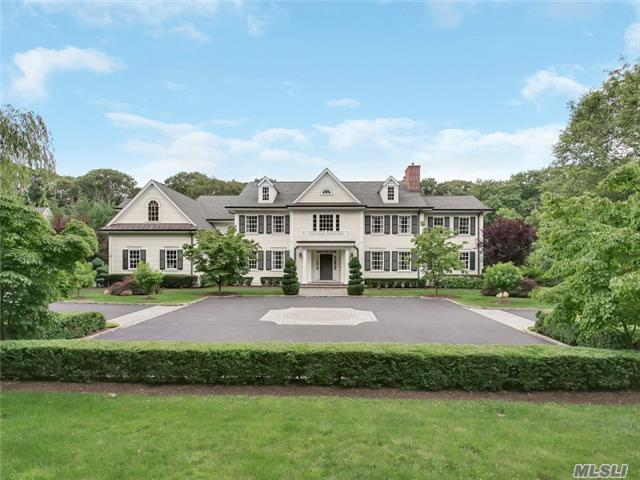 MUTTONTOWN. Custom built to the highest standards, with the ultimate in exquisitely crafted finishes, this magnificent 12-room colonial stands majestically on over 2 serene acres. Located on a quiet cul-de-sac lane shared with only a few equally grand residences, this 6-bedroom, 4-bath gem welcomes all with beautiful landscaping and a large front courtyard. Fully fenced, the immense rear property, with its expansive level lawn offers ample space for the addition of all one could want for summer entertainment. Ideally located in Muttontown, it is convenient to golf, boating, equestrian facilities, delightful village shopping and is within a comfortable commute to Manhattan. Adorned with intricately detailed wainscot and fielded paneling, the striking 2-story center-hall foyer is indicative of the splendid care given to every detail throughout the home. The equally lavish living room, with gas fireplace, and formal dining room, with butler's pantry, are ideal venues for gracious entertaining. The spacious French provincial eat-in-kitchen is both elegant and useful with cherry center island, granite-topped hand-glazed cabinetry, and high-end appliances. A bay window in the roomy breakfast area opens to the rear property. A study, powder room, staff bedroom and bath complete the first floor. Entered through double doors off the second floor landing that overlooks the foyer, the fabulous master suite boasts a palatial master bedroom with gas fireplace and lovely boiserie-detailed tray ceiling; a sunny sitting room/gym; 2 walk-in closets; and a luxurious marble master bath with free-standing tub, steam shower, dressing table, custom twin vanities and a bay window. A second lovely bedroom, with bath en suite, and a Jack-and-Jill suite, with connecting bath, are located on a separate wing that leads to a huge bonus room above the attached 3-car garage. A full finished basement with porcelain floors is spectacularly finished featuring a huge entertainment space with built-in