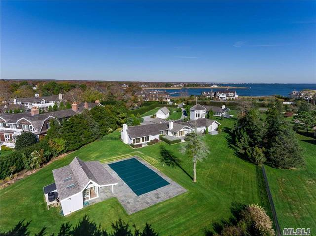 On Shinnecock Road, Quogue's Premier Location, Stands An Impressive Compound W/ 4 Legal Structures, (Can Never Be Duplicated Again). A 4113 Sq.Ft. Main House W/ 3 B & 4.5 Bths, A Tower Study W/ 360 Degree Views Of The Golf Course & The Bay. A Guest House W/ 1 Br & Kitchen Also Pool Cabana W/ Bth & 2 Car Garage. 20 X 45 Heated Gunite Pool. 1.73-Acres Park Like Grounds.