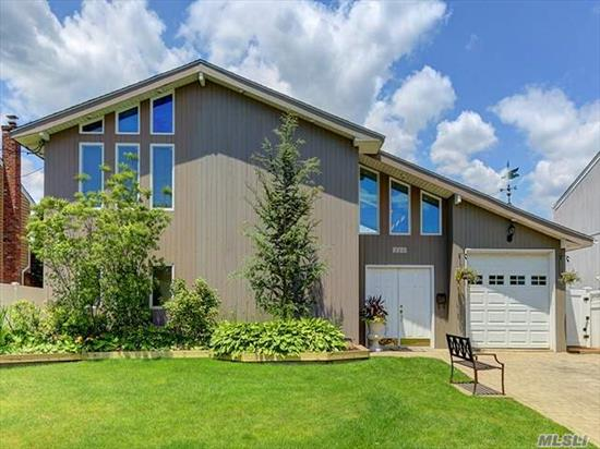 Stunning Contemporary Waterfront On Wide Canal. Vacation In Your Own Backyard With Pool (Brand New Liner) And Multilevel Decks. Beautiful Views From Great Living Space. Upper Level Boasts Open Layout Of Eik, Fdr, And Living Room With Sliders To Upper Deck. Newer Gas Boiler And Updated Electric Service. 3 Year Old Roof Too!. Many Updates Too Much To List!