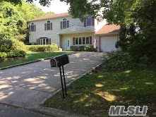 Spacious Colonial Featuring 5 Large Bedrooms On One Level! Eat-In-Kitchen W/Stainless Appliances, Magnificent 1/3 Acre Property Private Backyard, Underground Sprinklers, New Roof, Beautiful Private Backyard, Long Driveway