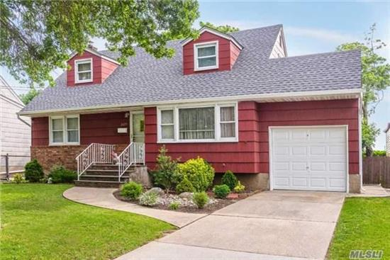 Perfect Oversize Cape Featuring Updated Eat In Kitchen, Banquet Size Dining Room, Family Size Living Room, 4 Great Size Bedrooms & Master On Main Level. Finished Basement, 1 Year Old Roof, 8 Year Old Boiler, & Central Air Conditioning. Kennedy High School, Near Shopping, Restaurants & Railraoad.