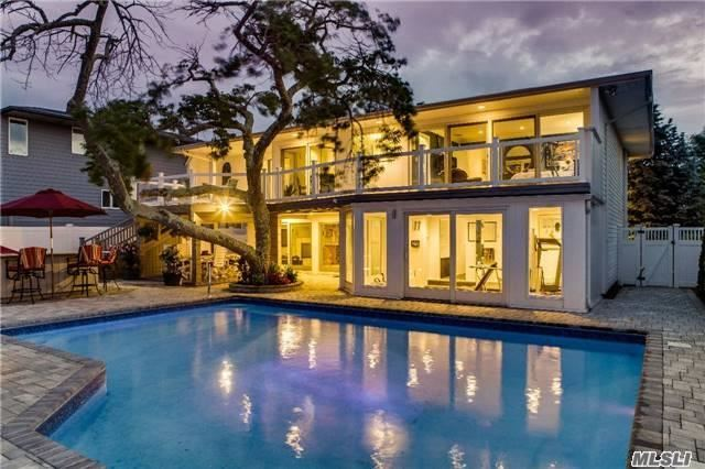 One Of A Kind Resort Style Bayfront Home W/ Magnificent Views Of Jones Beach. Enjoy A Private Oasis Or Entertain Guests In This Incredible Backyard W/ Heated In-Ground Pool, Timbertech Decking & Waterfront Access. This Immaculate Home Is Ready For You To Just Move Right In.