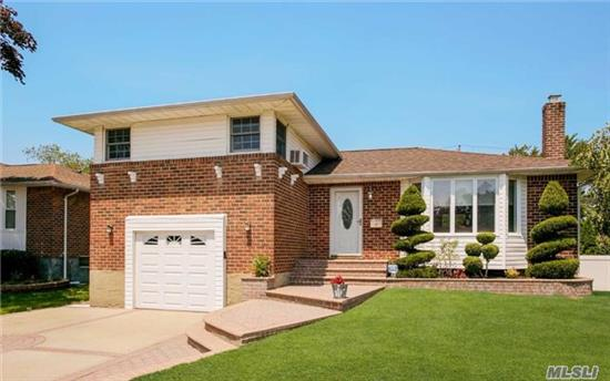 This Extremely Well Maintained 3 Bed, 3 Bath Split Includes A New Open Kitchen, Boiler & Hot Water Heater, Updated Bathrooms, Roof, Windows, Cac, Washer/Dryer, Garage Door, Driveway & Stoop. Great Layout For Entertaining Inside & Outside.