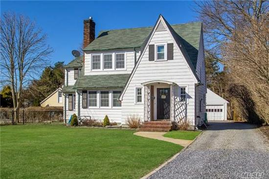Updated, Charming & Spacious 4 Br Colonial South Of Montauk Hwy! All New Andersen Windows, New Baths, New Heating & Electric, New Driveway, 2 Car Garage W/Loft, Shed, Large Deck Overlooking Oversized Property. Charming Features Thruout Inc. Hw Floors,  Arched Doorways, Copper Gutters, Built In Cabinetry. Full Basement W/French Drain System & Whole House Purifier.