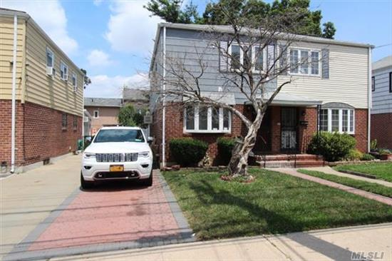 Semi-Detached One Family Home. Features 3 Bedrooms, 1.5 Baths, Living Room, Dining Room, Kitchen, And A Full Basement. Gas Heat. R4-1 Zoning.