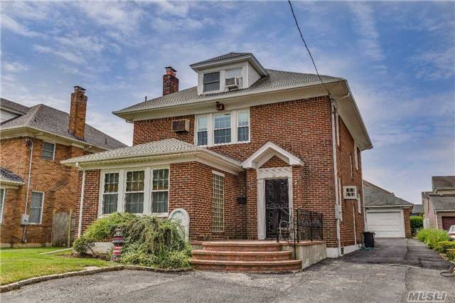 Brick Colonial Easy Walking Distance To Shopping, Schools And Houses Of Worship. 4 Levels Of Finished Living Space, Hardwood Floors Throughout, Updated Kitchen, New Boiler, New Hw Heater, New Windows, Deep Lot.
