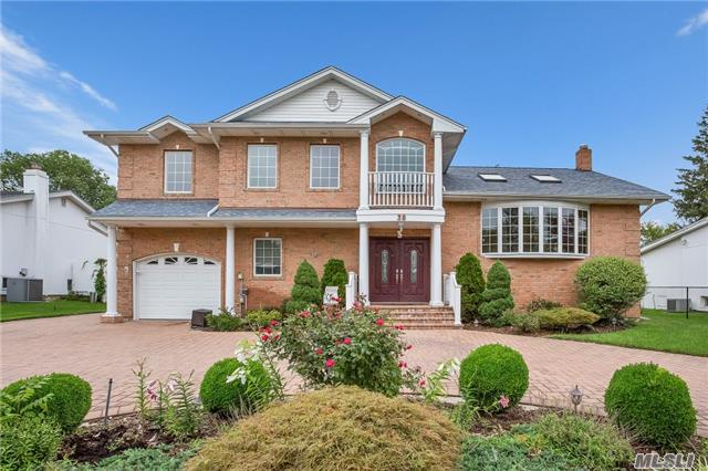 Stunning West Birchwood 2006 All Brick Home!Close To 4000 Sf Of Living Space! Spacious Layout W/Hi Ceilings!Dramatic Entry Leads To Lvrm, Custom Kitchen W/Designer Appl& Gas, 1st Fl Master Ste Plus 2nd Master & 3 Bdrms!Great Entertainment Home On 5 Lvls, Radiant Under All Tile, Wired For Sound, Large Yd W/Paver Patio, Faces South, Cantiague Elem!Too Many Extras!A Must See!