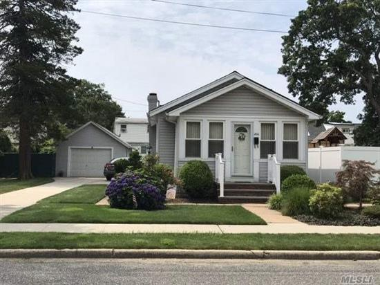 Charming Bungalow/Cottage Style Home Features: New Siding, Updated Windows, Updated Cac, Updated Bath. Updated Heat And Hw System. Part Finished Basement. Beautifully Landscaped. Low Taxes, Plainedge Schools. Please Note Bathroom Is In Basement.