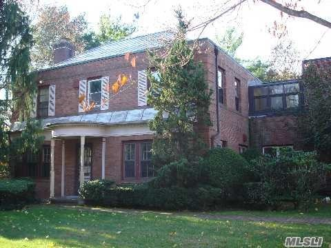 Beautiful Brick Colonial With Very Big Rooms, New Wood Floors, New Kitchen And Baths.
