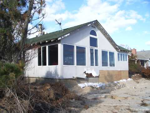 Bayfront Cottage. Panoramic Views With Sandy Beach. Great Room With Fireplace,  Eat In Kitchen,  Dining Area,  Master Bedroom With Master Bath And Additional 2 Bedrooms And Bath. Detached 2 Car Garage,  Deck And Dock Rights. Needs Tlc Best Buy