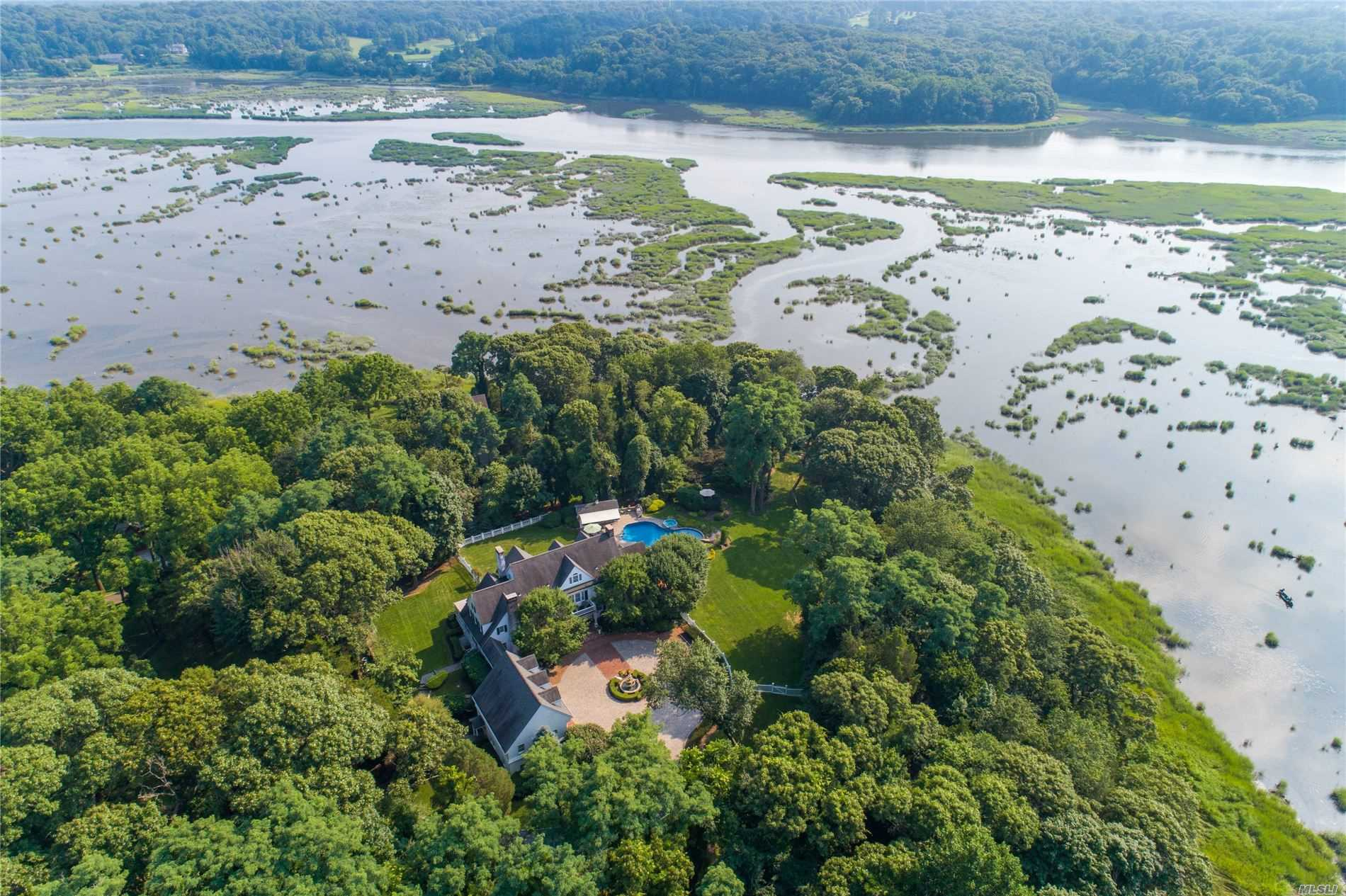 Architecturally and historically significant estate on 5 waterfront acres along the Nissequogue River. The home boasts 4 bedrooms, 4.5 bathrooms, 5 fireplaces, IGP with pool house, separate guest apartment, and painstakingly restored original details lending abundant charm to this idyllic setting.