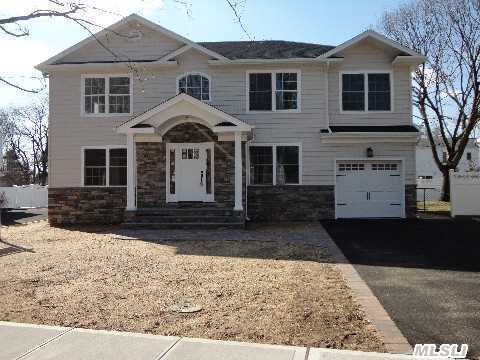 New Center Hall Colonial! Main Pic Is Of The Actual Home Being Finished In Wantagh Woods!! Close To All While In One Of The Nicest Neighborhoods. Lr-15X13 Fdr-12X15 Fr-17X17 Eik-14X28 Mbr-15X19 Br2-12.8X12.8 Br3-10.8X14 Br4- 14.10X12. All Sizes Are Approx. Interior Pics Are For Workmanship Purposes Only. Spec Sheet Prevails!