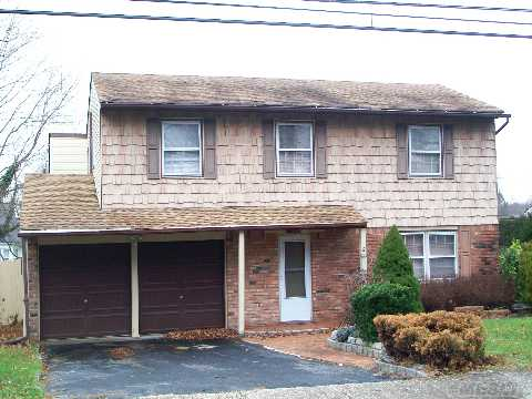 Mint Splanch Boasts Maple Kitchen W/Granite Counter Tops, New Boiler, Family Room W/F/P, Updated Bath, Updated Carpets, Some Hd/Wd Floors, Smithtown Schools!! Bring Checkbook!!!