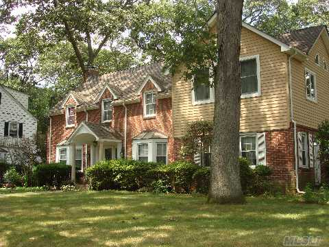 Approx. 3000 Sq Ft 5 Bdrm 4 1/2 Bath Merrick Woods Center Hall Colonial On 100X100 Lot For $629,000! Living Room W/Fireplace, Large Fdr, And Family Room. Eik, 3 Room Suite On First Floor. Huge Master Suite W/Spa Like Bath. Basement, Cac, Hardwood Floors