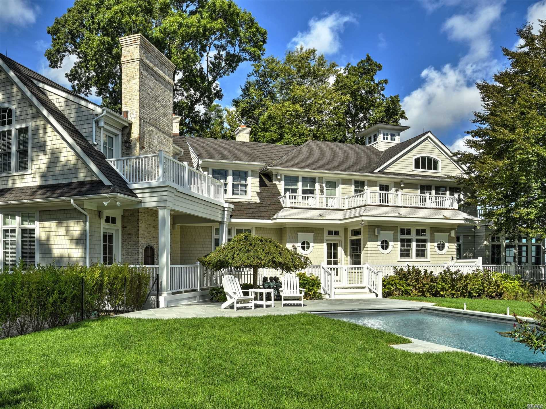 Enjoy The Tranquility Of Shelter Island. This 9, 230 Sq. Ft. Home Located On 1.7 Acres Was Rebuilt In 2010. Features Include Scenic Views Of Dering Harbor, 600 Ft Of Private Beach, A 168 Ft Deep Water Dock, A Deeded Mooring, Five Fireplaces, A Four-Car Garage, Home Theater Room, Library, Outside Pizza Oven, Wine Cellar And A Pool.
