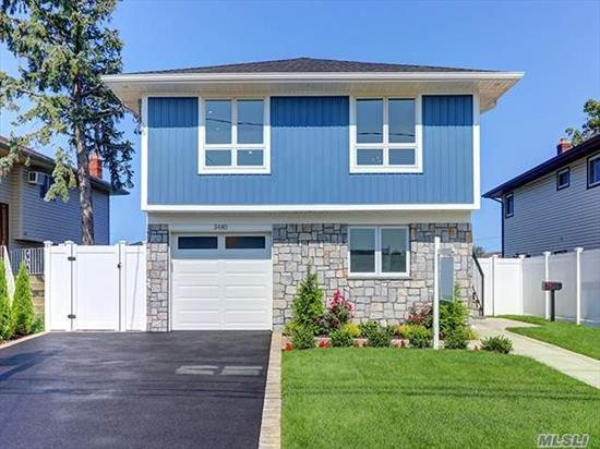 Diamond Contemporary On Wide Canal. Brand New Bulkhead, Inground Sprinklers And Professionally Landscaped Too. House Boasts Open Layout Eat In Kitchen, Dining Room And Living Room. Master Bedroom Suite With Huge Walk In Closet And Master Bath. Bedroom Has Slider To Balcony Overlooking Canal. New Central Air, Gas Heat, Windows, Siding And Roof Too. Too Much To List!
