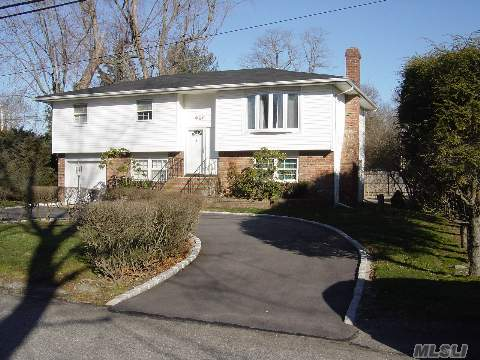 Spacious High Ranch, Large Rooms. Bright Eat In Kitchen W/ Sliders To Deck. Updated Windows. Hardwood Floors Throughout. Set On Cul De Sac With Circular Driveway. Half Hollow Hills School District #5. Taxes W/ Star $8502.08