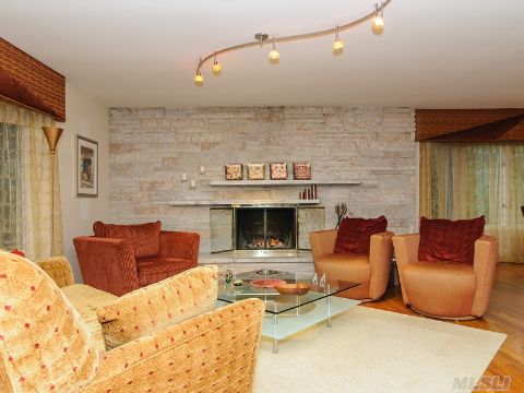 Inviting Living Room with Wood Burning Fireplace