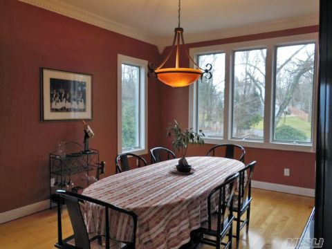 Banquet Size Window Wrapped Formal Dining Room With Oak Floors