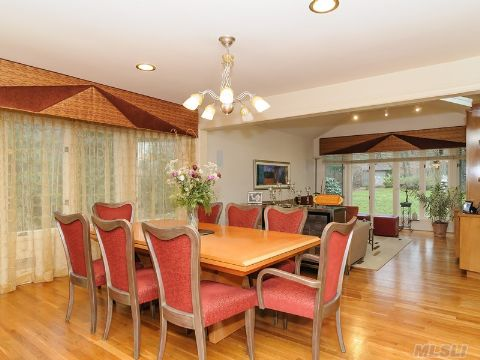 Living Room Flows into Dining Room and into Expanded Den