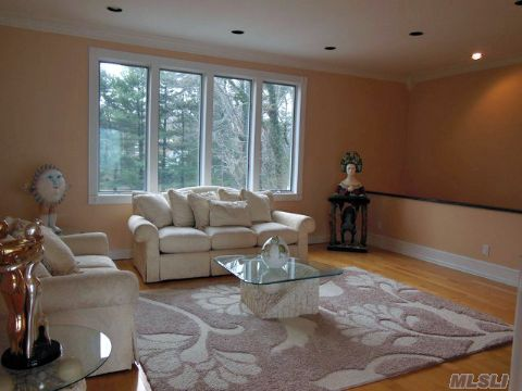 Entertainment Size Formal Living Room With Oak Floors & Sound Views
