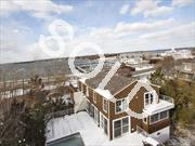 Absolutely Stunning Post Modern In The Heart Of Sag Harbor, Across From Marina W/Gorgeous Views Of The Harbor & Sound. Newer Construction W/Amazing Design & Craftsmanship, 'The Arc' Is Truly A One Of A Kind Hamptons Residence. 2 Master Suites, Sauna, Heated Gunite Pool & Timber Deck.The Best Entertainers Home A Short Stroll To The Village.A Rare Find That Is Priced To Sell