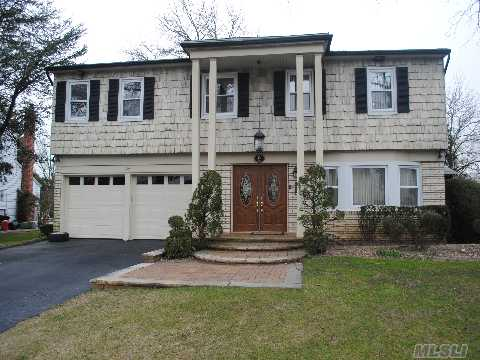 Warm And Inviting Colonial Set On A Cul-De-Sac In Manhasset Hills. Beautiful Updated Kitchen, Updated Bath, Finished Basement, 2 Car Garage, Nice Yard! A Must See To Enjoy!