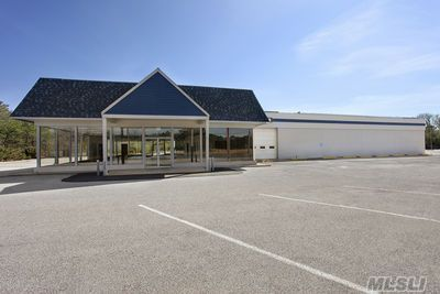 2.75 Acre Paved Lot, 15,918 Sq.Ft. Concrete Block Building.  Glass Enclosed Showroom  Zoned Highway Business
