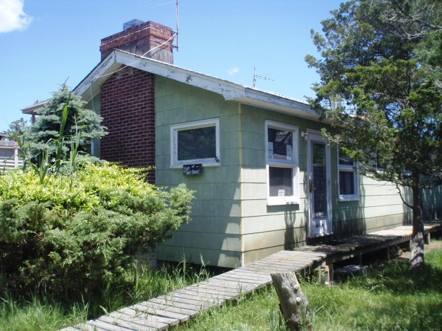 4 bedroom, private back deck, close to town, open kitchen and living room. $14,000 August to Labor Day, possible weekly rentals. Home is currently under reonvation slated to be completed May 1st. Call for details.