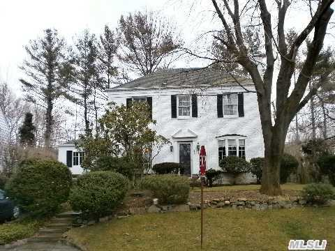 Magnif. Center Hall Colonial, Excellent Condition, Granite Modern Eik, Sub Zero Refridgerator, 3 Updated Baths, Updated Windows, Finished Basement, Living Room W/Fireplace, Den, Maids Room And Bath On 1st Floor, Lovely Backyard With Brick Patios, Walking Distance To L.I.R.R(23 Mins To Manhattan).
