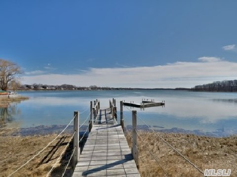 Waterfont, End Unit, Very Private. Drop Your Keys And Run To Play On Sound Beach Or Watersports, Fishing In Your Backyard. No Worries About Cutting Lawn Or House Maintenance. Newer Utilities, Baths. Amazing Waterviews, Fantastic Sunrise(S)- Sunset (S).  3 Bedroom - 2.5 Baths..Dreamy
