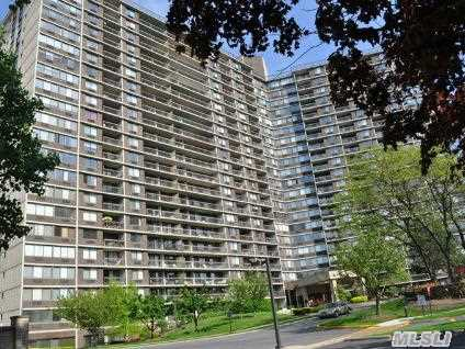 Fabulous Bay Club Gated Community. 24 Hr. Security. Doorman / Concierge Building. Large Studio Unit With Pantry.  High Floor W/ Bridge & Water Views. Year Round Swim & Fitness Center,  Indoor Parking,  Tennis Club (Extrs Fees). Underground Stores. On Premises Restaurant. Express Bus To N. Y. C. Accross Street Or L. I. R. R. Nearby 25 Mins. To Penn Station.