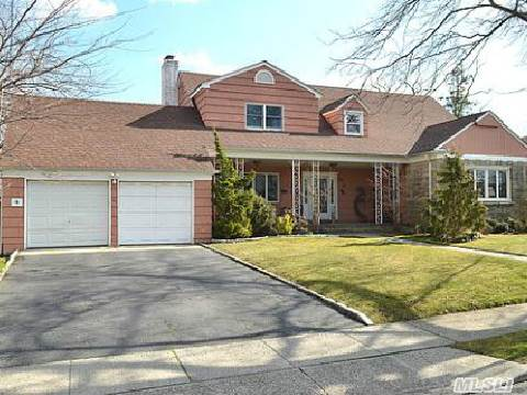One Of A Kind (91X 181) Property In The Heart Of Hewlett, Colonial 4 B/R, 2 Bth, New Roof,  New Windows, Luxurious Bath, Fully Alarmed, Redwood Deck, Prof. Gym In The Bsmt. Much More. Taxes $15.908.52  Walking Distance To Houses Of Worship. * Star Reduction $1604.07
