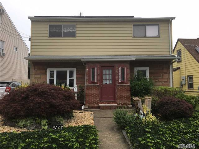 Beautiful One Family Home In Flushing. First Floor - Living Room, Eat In Kitchen, Two Bedrooms & Full Bath. Second Floor - Living Room, Galley Kitchen, Two Bedrooms & Full Bath. Private Driveway.