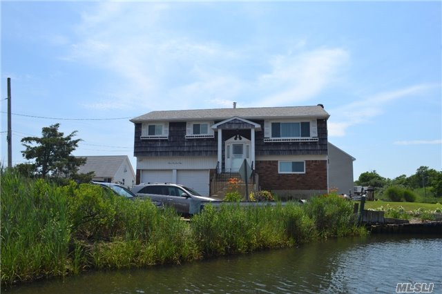Beautiful Water Views From Every Room, Waterfront Hi Ranch On Private Dead End Street. 182 Ft Updated Bulkhead W/ Boat Ramp, 2nd Story Deck, Well Maintained Home W/ All New Energy Star Windows, 200 Amp Electric, Landscaped Oversized Lot, 2 Minutes To Bay.
