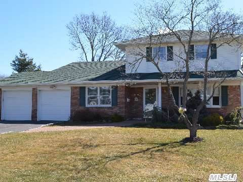 Beautifully Updated And Spacious Splanch Featuring: 5 Bedrooms, 2.5 Updated Baths, Updated Eat-In Kitchen W/ Oak Cabinets, Formal Living And Dining Rooms, Family Room With Fireplace And Sliders Leading To Large Deck With Retractable Awning.  Oak Flooring Throughout, Updated Roof, Siding, Windows, And Driveway, 2 Car Garage, A Must See!